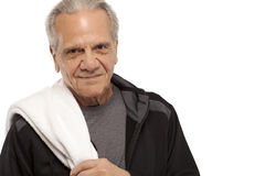 Senior man with towel during workout Stock Photography