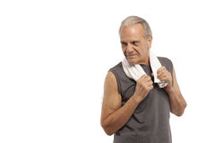 Senior man with towel during workout Royalty Free Stock Photos