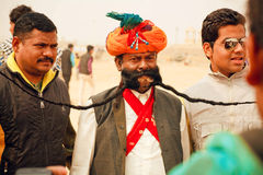 Senior man in traditional Rajasthan dress show the great mustaches during the Desert Festival in India Royalty Free Stock Photos