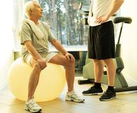 Senior man and trainer Royalty Free Stock Images