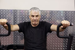 Senior man training in gym Stock Image