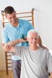 Senior man training with his coach. Senior men training with his coach in fitness studio Royalty Free Stock Photos