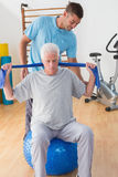 Senior man training with his coach Royalty Free Stock Photography