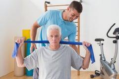 Senior man training with his coach Stock Photos