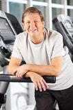 Senior man on treadmill in fitness Royalty Free Stock Photography