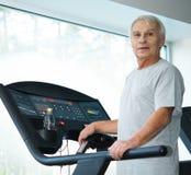 Senior man on a treadmill Royalty Free Stock Photos