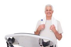 Senior man on the treadmill Stock Photography