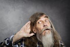 Senior man tries to listen sound, elder hearing loss deafness. Senior man tries to listen sound. Elder hearing loss deafness Stock Image