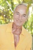 Senior man in a tropical setting Stock Photos