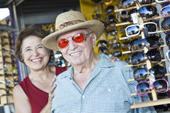 Senior Man Trying Sunglasses At Shop Royalty Free Stock Photography