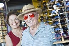 Senior Man Trying Sunglasses At Shop Royalty Free Stock Photography