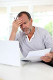 Senior man trying to figure out the tax declaration Stock Photo