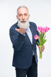 Senior man with tulips Stock Images
