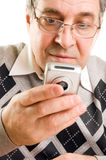 Senior man typing on mobile phone Stock Photos