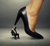 Senior man under big female heel Royalty Free Stock Images