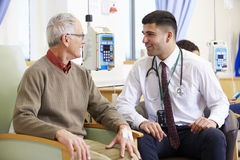 Senior Man Undergoing Chemotherapy With Doctor Stock Photography