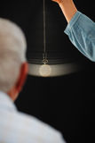 Senior man undergoing hypnotherapy treatment Royalty Free Stock Photo