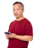 Senior man use of cellphone Stock Photo