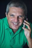 Senior man using cell phone. This picture represents a senior man using his cell phone Royalty Free Stock Photos