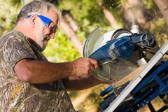 Senior Man Using a Circular Saw Stock Photos
