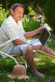 Senior man using computer  Stock Photo