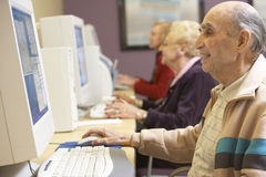Senior man using computer Stock Images