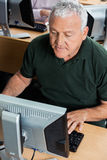 Senior Man Using Computer In Classroom Royalty Free Stock Photography