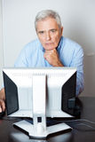 Senior Man Using Computer In Classroom Royalty Free Stock Images