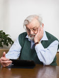 Senior using digital tablet Royalty Free Stock Photos