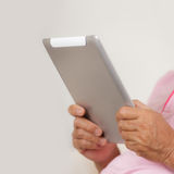 Senior man using digital tablet Royalty Free Stock Image