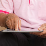 Senior man using digital tablet Stock Photos