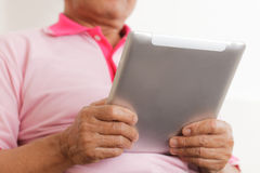 Senior man using digital tablet Stock Image