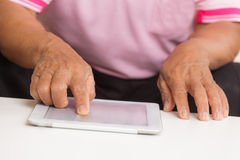 Senior man using digital tablet Stock Photography