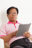 Senior man using digital tablet Stock Images