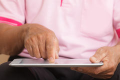 Senior man using digital tablet Royalty Free Stock Photography
