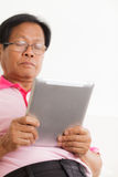 Senior man using digital tablet Royalty Free Stock Photo