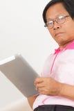 Senior man using digital tablet Royalty Free Stock Photography