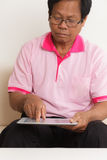 Senior man using digital tablet Royalty Free Stock Images