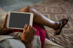 Senior man using digital tablet in the living room at home Stock Photography