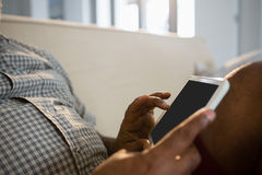 Senior man using digital tablet in the living room at home Stock Image