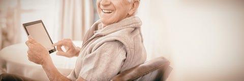 Senior man using digital tablet royalty free stock photos