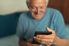 Senior man using digital tablet. royalty free stock image