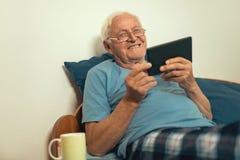 Senior man using digital tablet. stock image