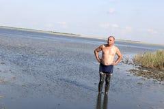 Senior man using healthy mud Royalty Free Stock Photography