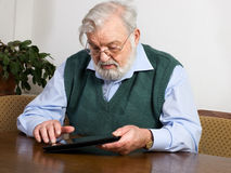 Retiree using digital tablet Royalty Free Stock Image