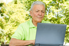 Senior man using laptop Royalty Free Stock Photos