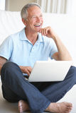 Senior man using laptop computer Royalty Free Stock Photo
