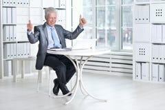Senior man using laptop Stock Image