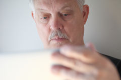 Senior man using laptop Stock Photo