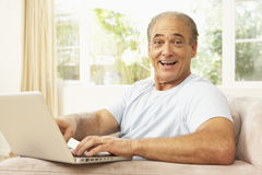 Senior Man Using Laptop At Home Stock Photography
